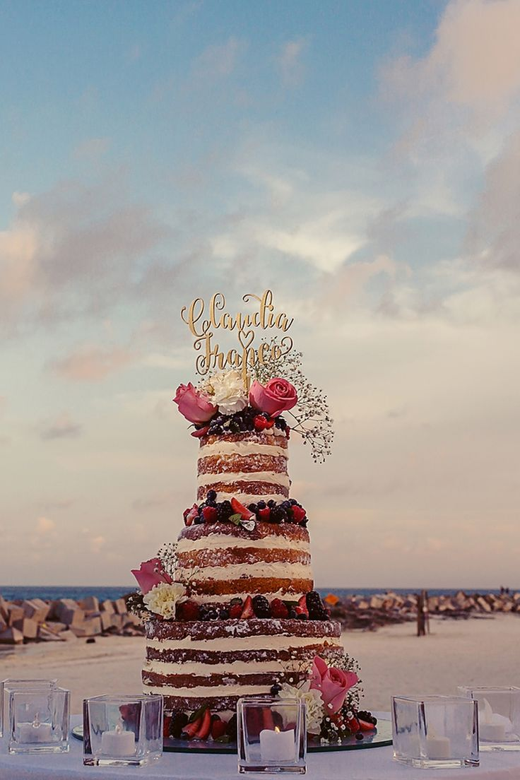 We adore this whimsical tall naked wedding cake with flowers and a gold script cake topper! (Quetzal Wedding Photo)