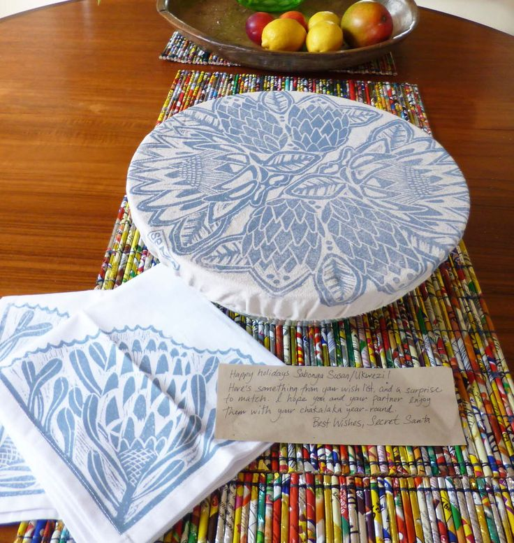 """Susan says, """"Here is my Protea bowl cover with napkins. Photographed on top of mats made from rolled up crisp packets. I do love living in this creative place Africa!"""""""
