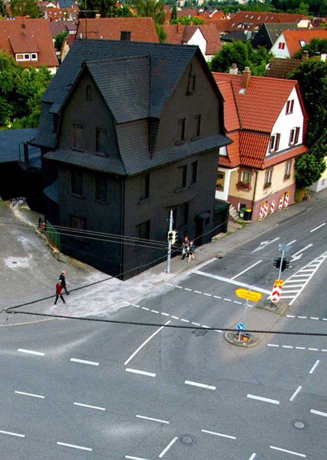 Haus in Schwarz (House in Black) was a 2008 public art piece by artists Erik Sturm und Simon Jung (previously) in the city center of Möhringen, Germany. The piece was meant as a farewell to the building which was slated for demolition, with the matte black paint acting as a sort of final curtain.