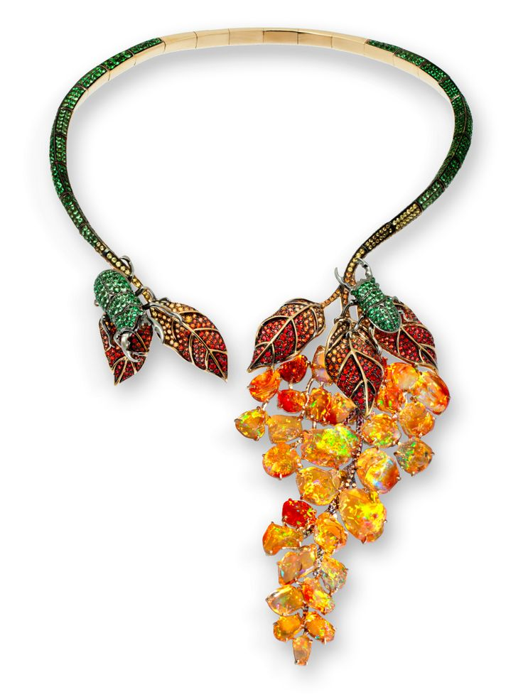 Necklace in yellow gold and black rhodium set with fire opals, sapphires and green garnets by Lydia Courteille, Paris.