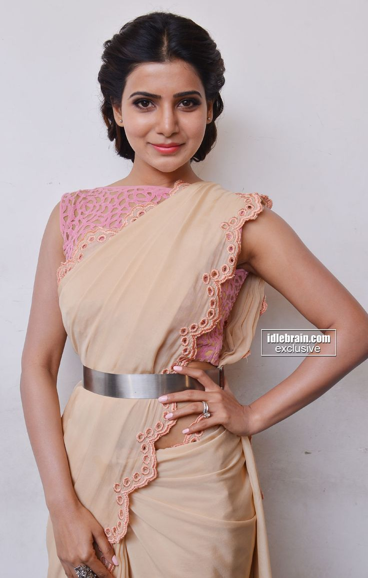For a really sexy look, belt up your saree. It will keep everything in place and make your waist look tiny.