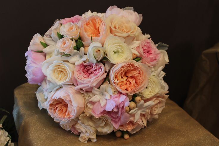 hand tied bridal bouquet of blush peach and pink garden roses, pink peonies, white hydrangea, stephanotis www.frugalflower.com