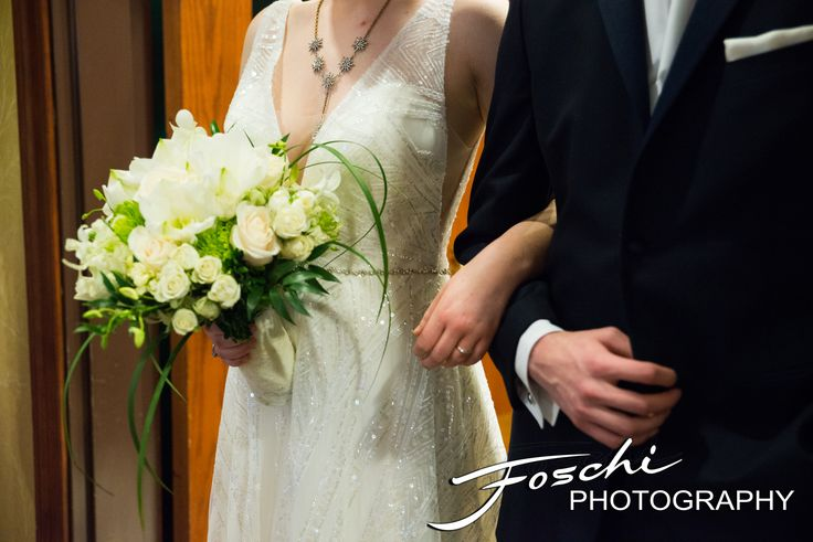 Classic white bridal bouquet with a rustic vibe with beautiful roses and ranunculus. Foschi Photography.