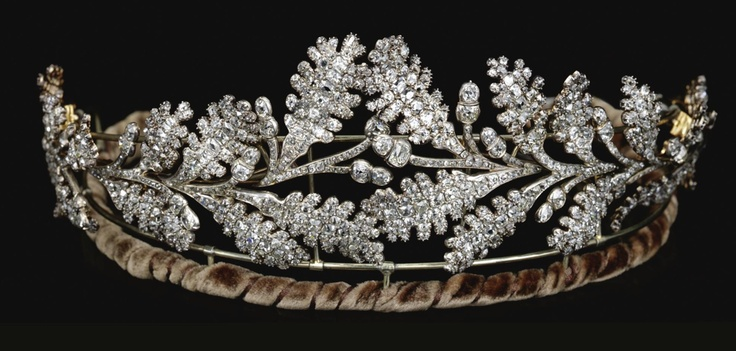 DIAMOND TIARA,  EARLY 19TH CENTURY.   Designed as two confronting sprays of oak leaves tapering from the centre, set throughout with old mine diamonds,    accompanied by fitted case stamped Carrington & Co. Jewellers, 130 Regent St., London .W.  inner circumference approximately 370mm, may also be worn as four brooches.
