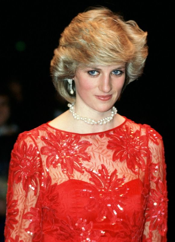 Princess Diana wears a red lace dress on her first solo oversea tour to Norway in February 1984.