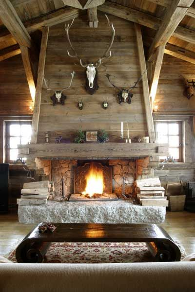 Doesn't this place make you want to cozy up by the fire? | Rustic mountain living room.