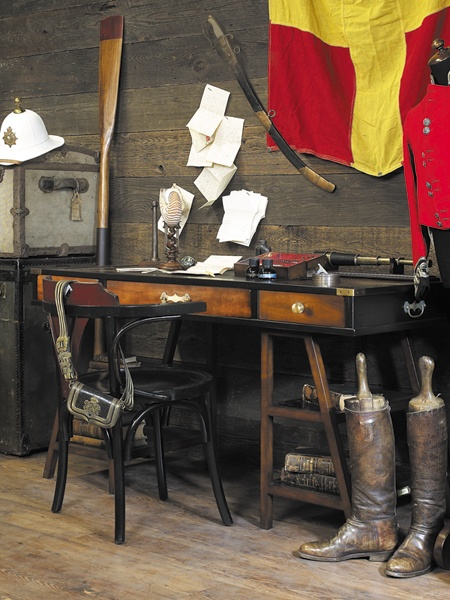Multi-functional and easily stowed Navigator's Desk. The supports could be used to mount a top berth or a camel, as the case may be. The desktop could deflect musket fire or cache treasure maps. $1,495