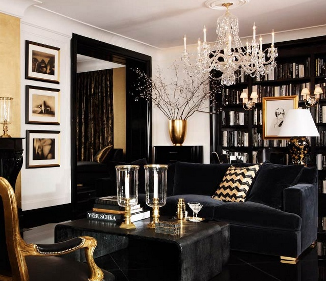 Elegant. I love the contrast of the black door frame and the cream colored walls. the gold accents and the chandelier provide just the right touch of historical elegance w/in a modern setting!