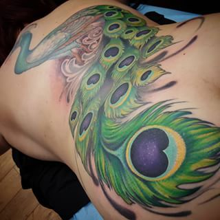 Peacock tattoo side and butt <3