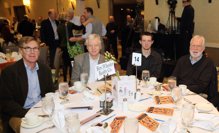 """Alex Ix, Jim McVay, Chris Saunders, and Mike Gilmore at the Roy Wheeler Realty table. """"Jimmy Miller's Bracket Breakfast for Piedmont CASA"""" on March 14, 2016. Image by Jennifer Byrne Photography."""