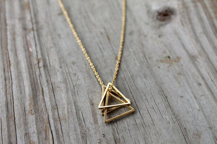 Gold Triangle Stack Necklace - 14K Gold Filled Triangle Necklace - Gold Geometric Pendant Necklace - Simple Everyday Necklace - Minimalist by JewelryVV on Etsy https://www.etsy.com/listing/196061109/gold-triangle-stack-necklace-14k-gold