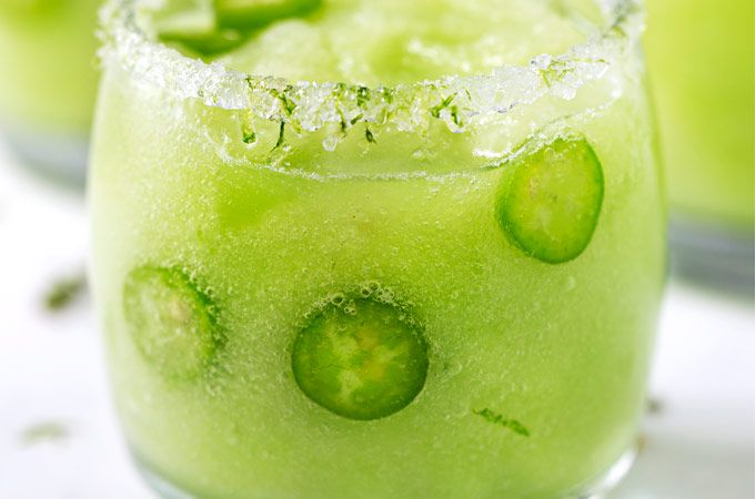 Sip your troubles away with this sweet frozen honeydew margarita with a kick! This jalapeño margarita has a perfect amount of heat to liven up your summer!