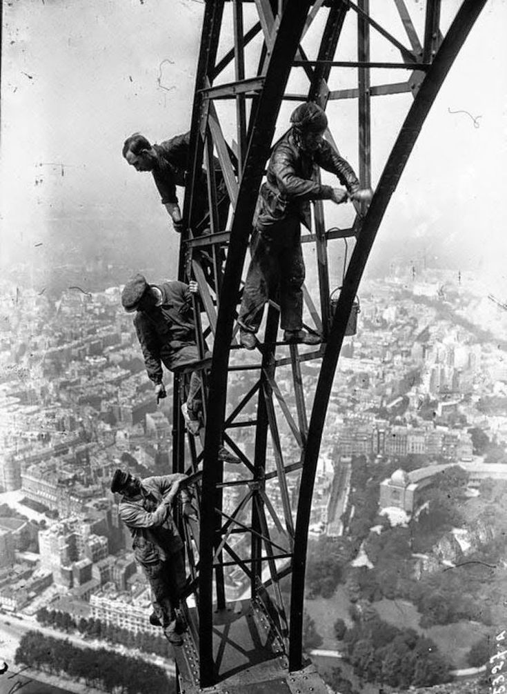 Workmen painting the Eiffel Tower, 1932