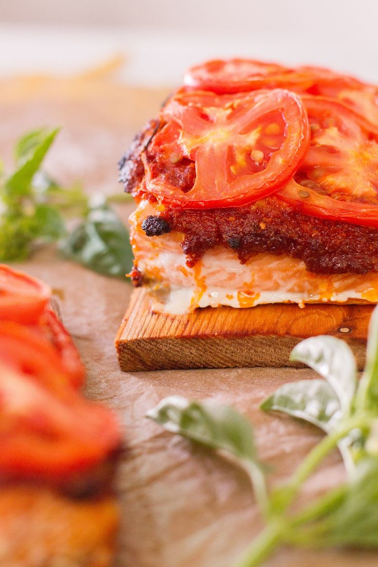 A simple recipe for Cedar Plank Salmon from McCormick & Schmick's with a Sundried tomato pesto and topped with fresh Roma tomatoes #recipe #salmon
