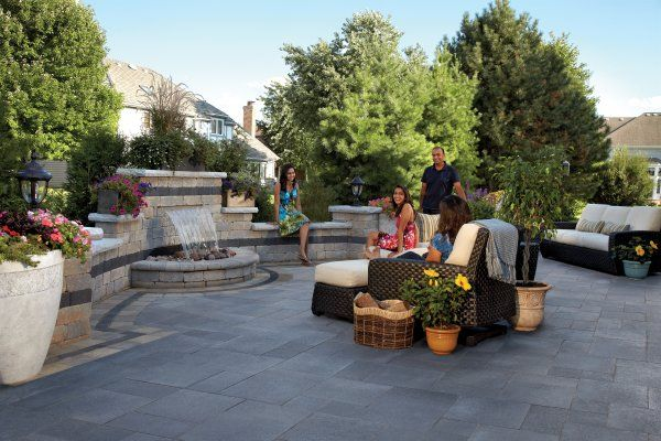 Outdoor living with Umbriano paver and Olde Quarry water feature