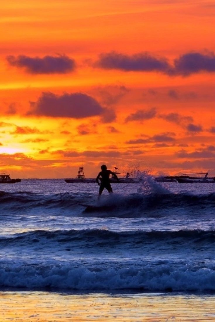 Surfing into the sunset at Playa Tamarindo #CostaRica #surfing