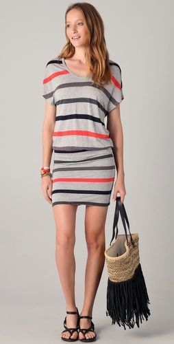 This striped jersey dress features a scoop neck and a formfitting skirt. Ruching at waist. Short sleeves.