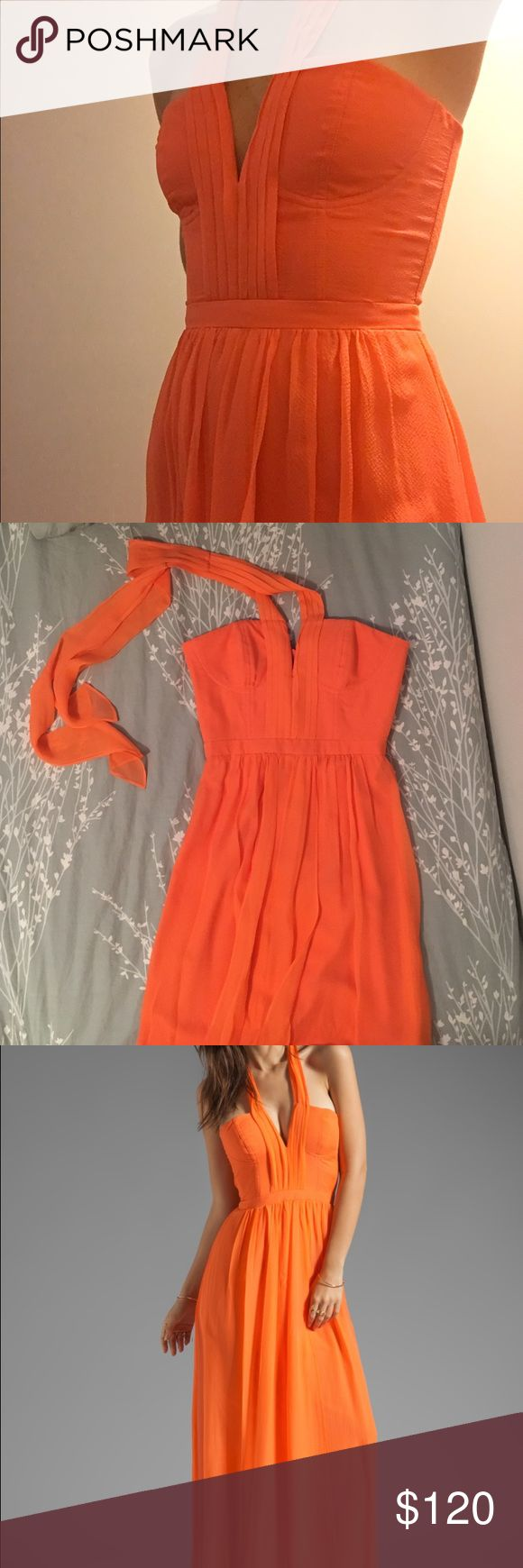 BCBG MaxAzria Full Length Dress BCBG MaxAzria orange gown. Size 0. Fitted top with a flowing bottom. Zipper is in the back.  Tie around the neck does not bare any weight. Perfect for a special/formal occasion. BCBGMaxAzria Dresses Prom