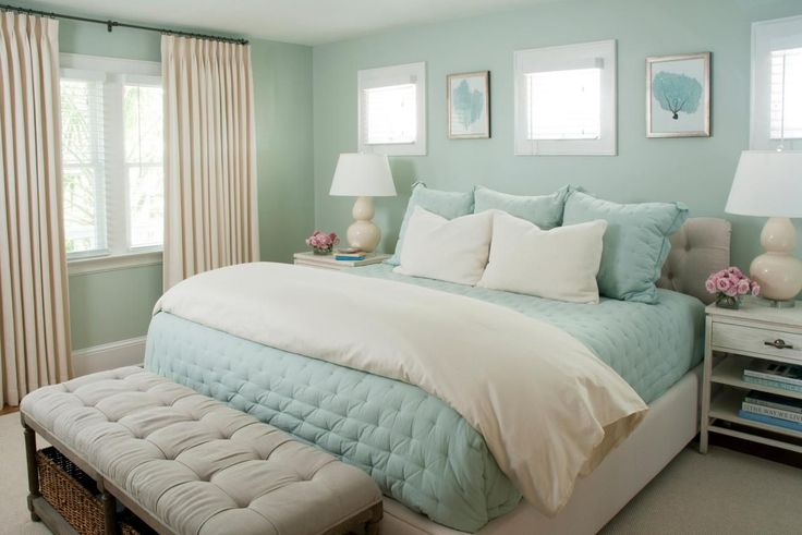 HGTV loves this dreamy coastal bedroom with seafoam green walls, pale blue bedding and creamy curtains.