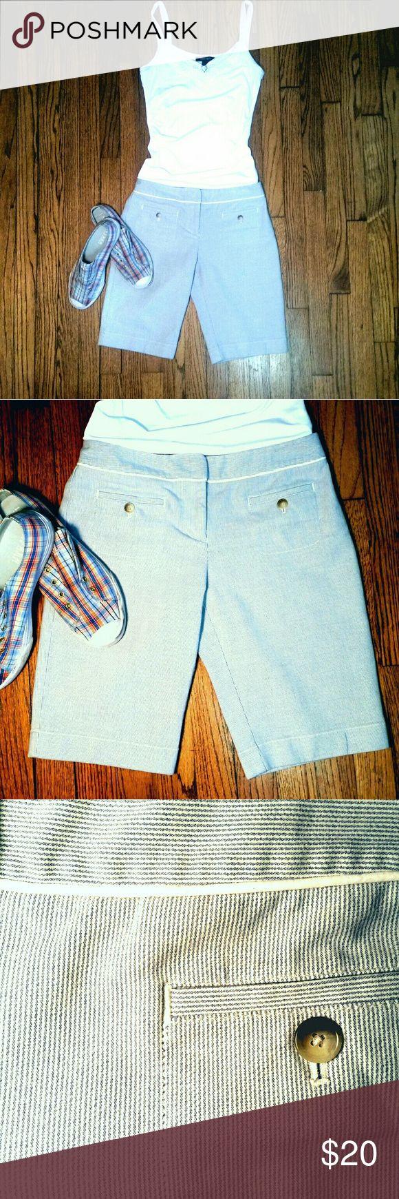 "Ann Taylor Pinstriped Shorts Blue and white mattress ticking pinstripe shorts by Ann Taylor. Flat front, front slash pockets, 2 back pockets, inseam 11"". Ann Taylor Shorts Bermudas"