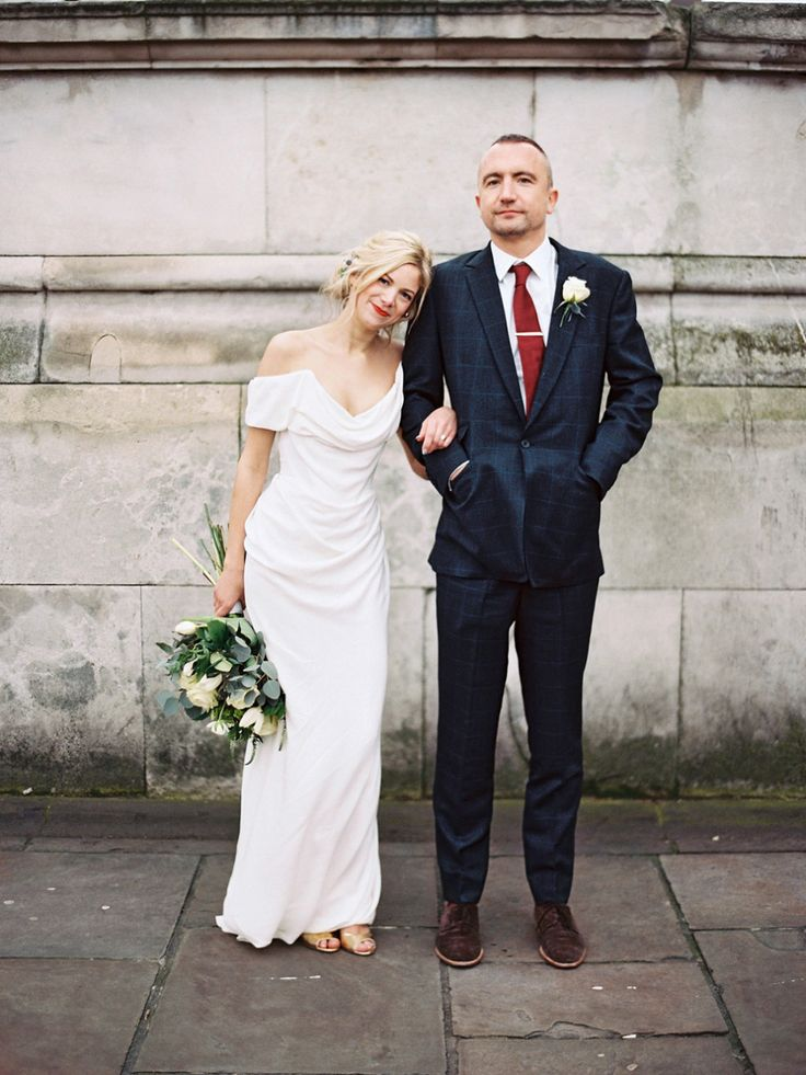 The bride wears Vivienne Westwood and Gold Rupert Sanderson shoes for her wedding at The Asylum in Peckham, London. Photography by David Jenkins.