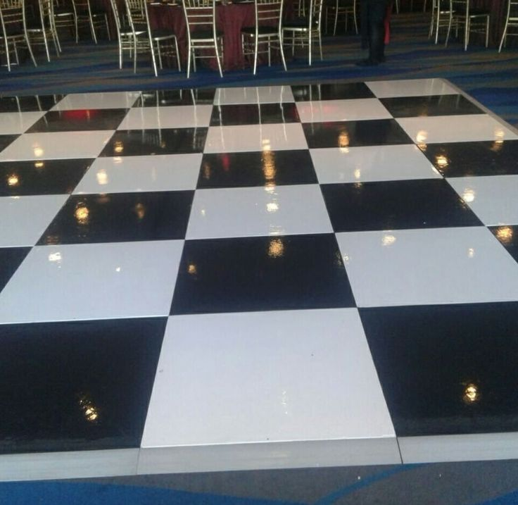 painted black and white check floor shining in the lights. #connectafloorcape #eventflooringcapetown