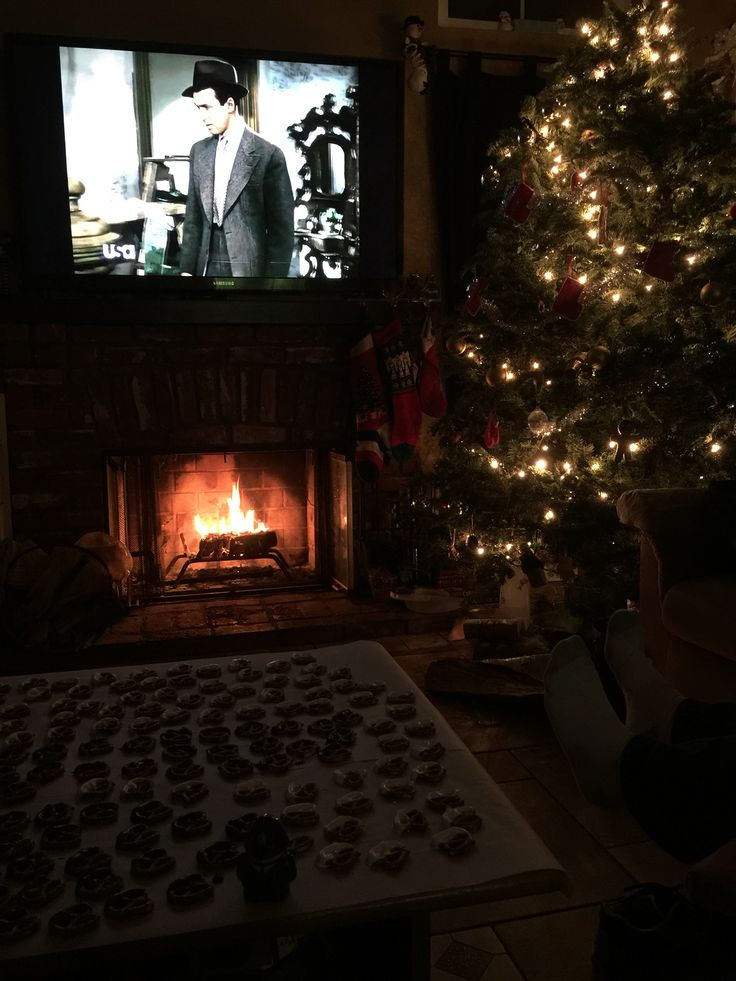 Day 20 of PostJoy Seasonal movies This pic says it all.   Christmas tree.  Burning fire.  Dipping pretzels. Husband close by.  Both drinking a little port. Watching our fave Christmas movie.    Good times! We would love to know - What's your favorite Christmassy movie?    #postjoy