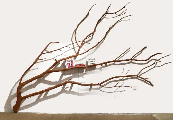 Branch bookshelf. I would not use this a a bookshelf, but as wall decoration in a big house!