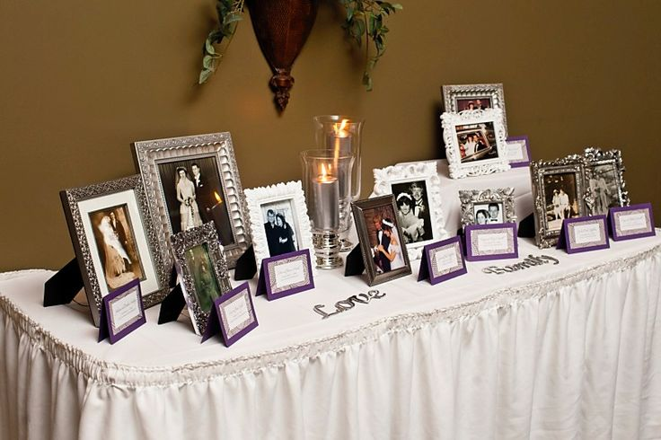 generations of family wedding photos at reception entrance -- what a great idea. it also helps with those who aren't here anymore.