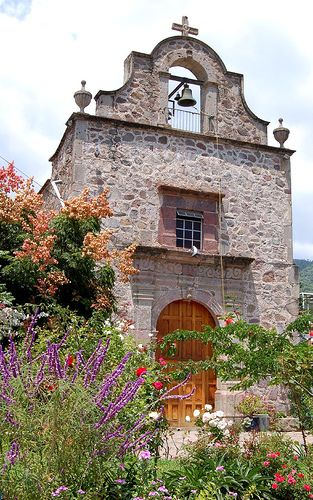 Old, Small, Ajijic, Mexico Church    During the rainy season flowers abound at the old church in the town square, Ajijic, Jalisco, Mexico.
