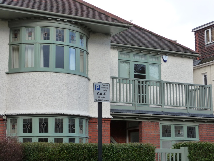 Menelik Road - house with original stained glass windows and (?) wooden balcony rail.