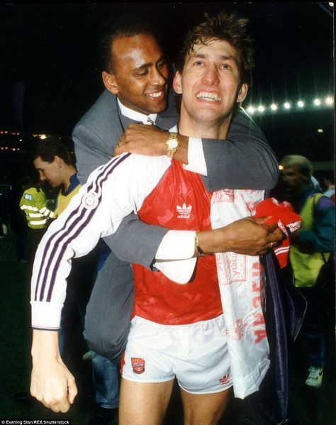 Rocastle jumps on Arsenal captain Tony Adams in celebration on the day George Graham's sid...