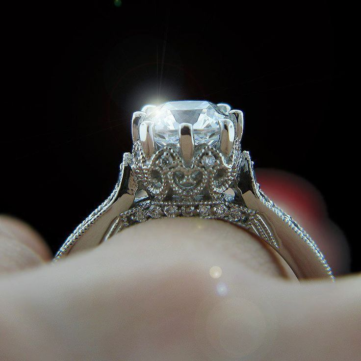 I think it looks like Cinderella's pumpkin coach. A little girly and whimsical but I still kinda love it. (http://www.miadonnadiamondblog.com/vintage-engagement-rings-trend-here-to-stay/12348/miadonna_custom-antique-engagement-ring_2/)