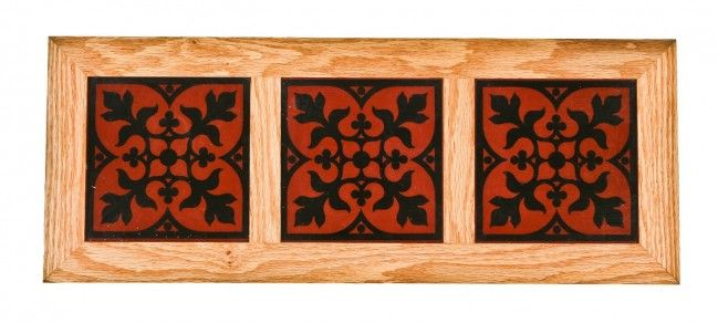 Three matching original vibrantly colored 19th century David C. Cook mansion interior encaustic or ceramic floor tiles mounted in a custom-built oak wood displayable frame.