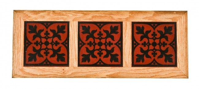 Three matching original vibrantly colored 19th century David C. Cook mansion interior encaustic or ceramic floor tiles mounted in a custom-built oak wood displayable frame.