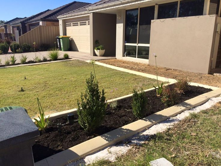 Beautiful front lawn that is easy to maintain thanks to the garden edging and easy care plants. Done by Down to Earth Landscaping & Concreting.