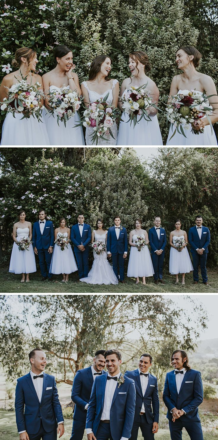 White strapless bridesmaid dresses and groomsmen wearing blue suits and bow ties | Nectarine Photography