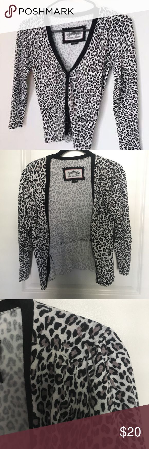 Grey Leopard Guess Jeans Cardigan Sweater Black, white and grey leopard Cardigan. Black vneck color. Black bead buttons. Ruched shoulders and back. ribbed waistline and cuffs. Very soft and comfy but flattering. Can be worn buttoned as a sweater of as an open Cardigan. Guess Sweaters Cardigans