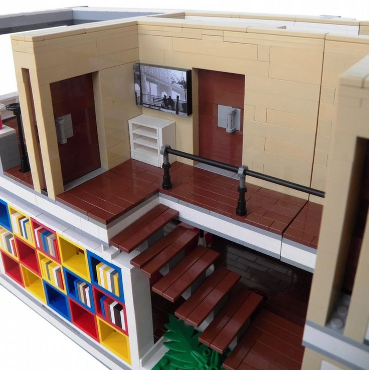 Really neat LEGO making, I like the way the stairs are behind the bookshelf and everything is just SO modern!