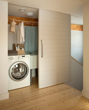 The Laundry closet is such a great and creative idea. It is compact and easy to camouflage. Also a good thing considering it is close to the bedrooms upstairs. Contemporary Laundry Room by Belfast Architects & Designers GO LOGIC