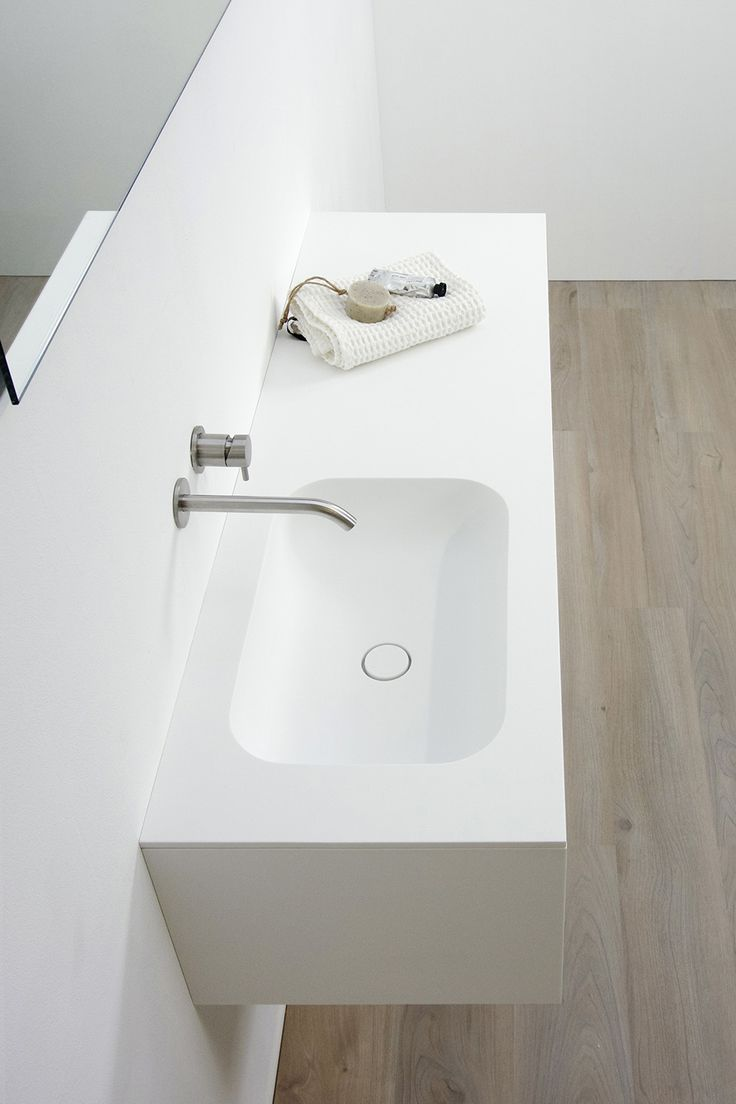 Curve; Curvaceous appeal. Defined by its smooth inner corners the Curve basin is not only aesthetically pleasing but also easy to clean. The seamless transition from basin to top makes for an uninterrupted design. Entirely made from strong scratchproof HI-MACS solid surface. With clean lines and curvaceous appeal the Curve basin complements both classic and contemporary settings. #bathsbyclay #Curve #madetomeasure #HIMACS #bathroomdesign #designwithoutcompromise