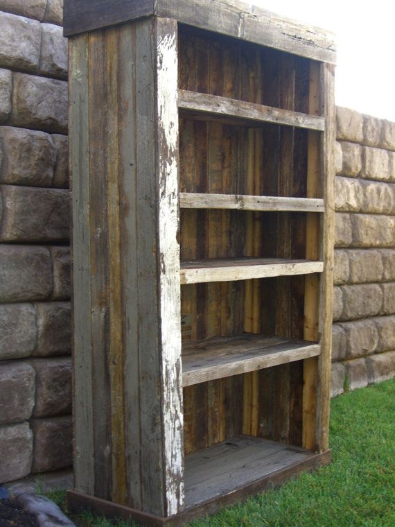 Reclaimed barn wood bookcase that's super sturdy with a little bit of white to break up the natural wood color.