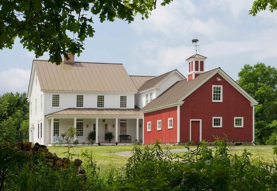 houses that look like barns Exterior Farmhouse with chimney cupola gable roof