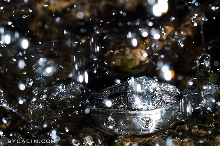 I took this massive diamond ring shot on the rocks at Paletta Mansion. Two flashes, water pouring over the rings and click!!!  Image by www.bycalin.com