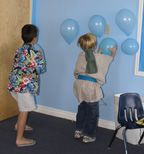 "Blow up blue balloons and put on the floor. Explain how the Red Sea parted into ""walls"" on both sides. Show kids how to rub balloons on their hair or carpet and stick to wall. Divide into two teams and have them do as many as they can in a certain amount of time. Count balloons, team with more on their wall wins."