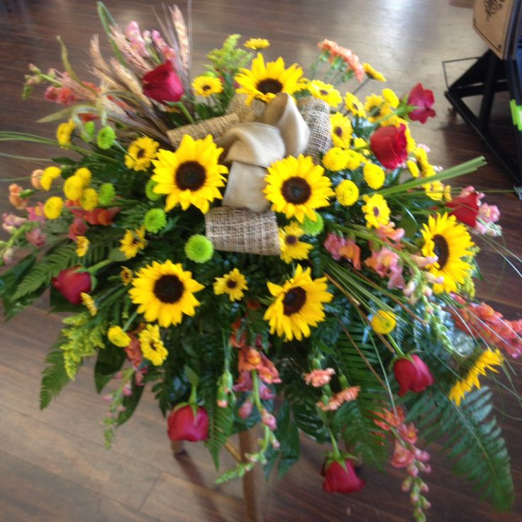 Masculine casket spray with sunflowers and burlap