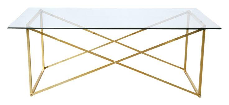 """Klassiskt soffbord i mässingsfärgad metall och härdat glas. Nätt underrede och skiva av glas. 65x120 cm höjd 46 cm. Montera själv. Vikt 21 kg. Läs om fraktavgiften under fliken """"Leverans""""."""