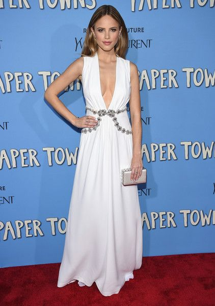 Halston Sage Evening Dress - Halston Sage worked a sultry-goddess vibe at the 'Paper Towns' New York premiere in a white Miu Miu gown with a down-to-the-navel neckline and a bejeweled waist.