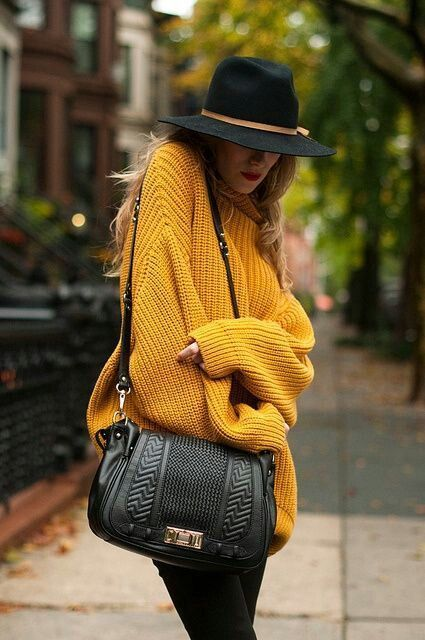How to Style a Chunky Knit Sweater - mustard yellow chunky sweater + fedora hat and black textured crossbody bag   StyleCaster