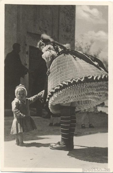 From Buják, Hungary. Vintage photo of traditional dress....how many petticoats can a gal wear?